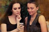 Young Women Looking at Smart Phone Screen