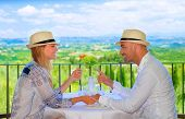 Young couple having breakfast on the terrace in restaurant, Europe, Italy, Tuscany, wonderful view,
