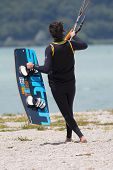 Kitesurfer Launches His Kite In The Lake Of Santa Croce