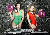 Two Beautiful Sexy Disco Dj Women In Bikinis Performing In A Club Setting
