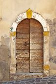 Antique door in center Italy style