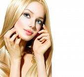 Beautiful Blond Girl isolated on a White Background. Blonde Long Smooth Healthy Hair. Beautiful Youn