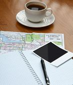 Photo , notebook pen and cup of coffee