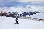 Young Skier Enjoy Skiing At The Slope In The Austrian Alps
