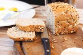stock photo of home-made bread  - home made bread on wooden board near tapas outside cafe - JPG