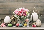 Easter Stillife. Tulip Flowers And Colored Eggs