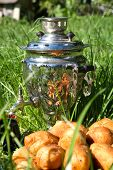 Samovar On A Green Grass With Cakes And Candies Berries