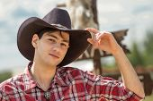 stock photo of wrangler  - Cowboy on sign background - JPG