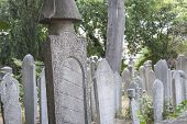 stock photo of headstones  - Old ornate islamic headstones in turkish graveyard - JPG