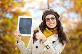Successful Woman Holding Digital Tablet In Autumn