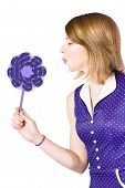 Pretty Pin Up Girl Playing With Purple Pinwheel