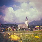 Retro Style Alpine Village With Flowers