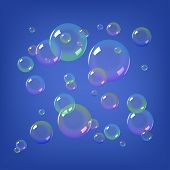 Soap bubbles on blue background