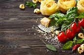 picture of ingredient  - Italian food ingredients for cooking pasta on a wooden background with copy space.