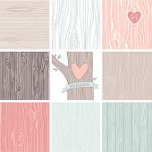 Woodgrain, wooden texture background and a carved heart in a tree, perfect as wedding backgrounds an
