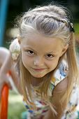 Close up, Little blonde girl in summer park