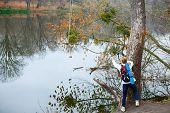 Young Woman Hiker Near Autumn River