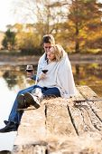 picture of snuggle  - romantic young couple snuggle outdoors in autumn - JPG