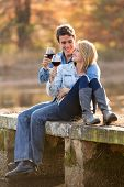 romantic couple drinking red wine outdoors