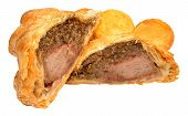 image of beef wellington  - Traditional beef Wellington cut in half with filling exposed and roasted potatoes - JPG