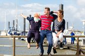 Friends enjoying vacation at German north sea ship pier
