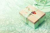 Gift box with green bow on abstract background
