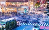 picture of intersection  - People and vehicles cross the famously busy Shibuya scramble intersection in Tokyo - JPG