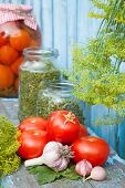 Homemade Canned Tomatoes In Glass Jar. Fresh Vegetables And Spices.