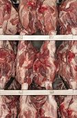 Closeup of raw meat hanging on rack