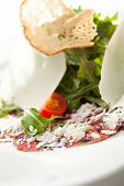 Appetizers - Beef Carpaccio with Parmesan Cheese, Rucola and Cherry Tomato