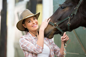 pic of cowgirl  - happy cowgirl and her horse in stable - JPG