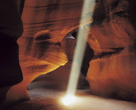 stock photo of landforms  - Ray of Sunlight in Cave - JPG