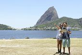 Tourist couple in Rio de Janeiro in front of the Sugarloaf Mountain, Brazil