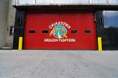 stock photo of firehouse  - Garage doors to a New York City firehouse - JPG