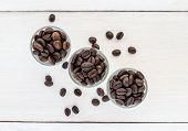 Coffee Beans In A Glass On Wooden