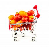 Colorful Bunch Of Small Grape Tomatoes In Shopping Trolley Isolated On White