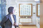 Woman Entering Into An Optician Store