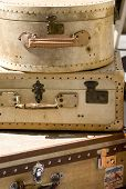 stock photo of hasp  - A pile of old suitcases well worn with hints of where they have been - JPG