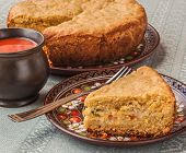 Portion Of Oat Flour Cake And Mug  Of Tomato Juice