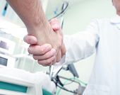The Doctor Shakes Hands With A Patient