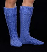 Blue gaiters from wool on female feet