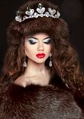 stock photo of mink  - Beautiful brunette woman in mink fur coat - JPG