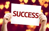 Success card with heart bokeh background