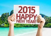 2015 Happy New Year card with a beach on background