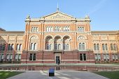 LONDON, UK - DECEMBER 20: Garden entrance to Victoria and Albert museum in bright sunny day. December 20, 2014 in London.