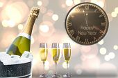 Black and gold new year message against champagne cooling in ice bucket
