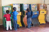 Children Playing Bingo Arcade Games