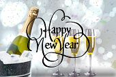 Happy new year against champagne cooling in ice bucket