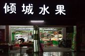 Traditional Chinese Market With Neon Advertising