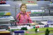 Girl examines exposure in mobile exhibition and lecture complex of Russian Railways